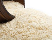 rice background with wood bowl