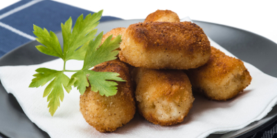 A plate with homemade croquettes decorated with parsley